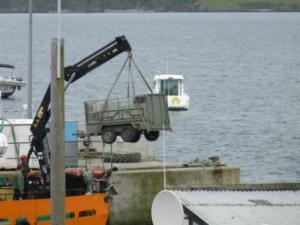 The trailer carrying our equipment being lifted onto the ferry.